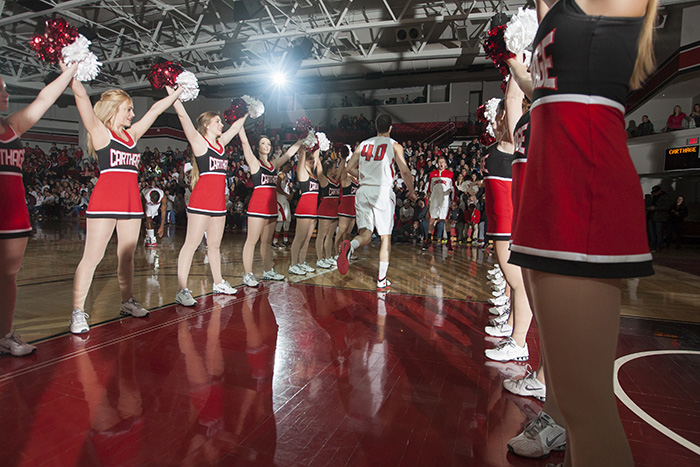 cheerleaders in a row on a basketball court